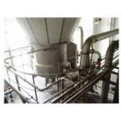 Precision fluidized spray dryer
